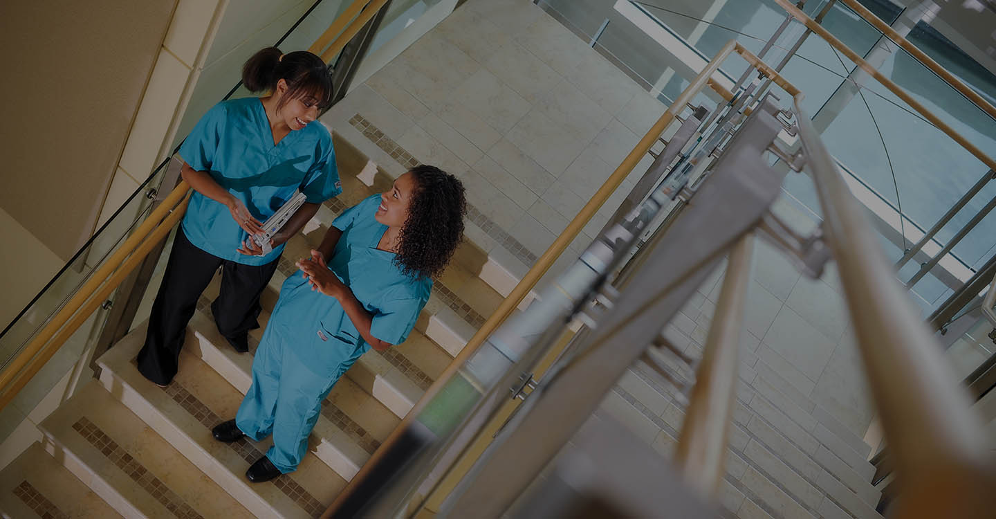 Nurses walking down the stairs in the AdventHealth for Women main lobby