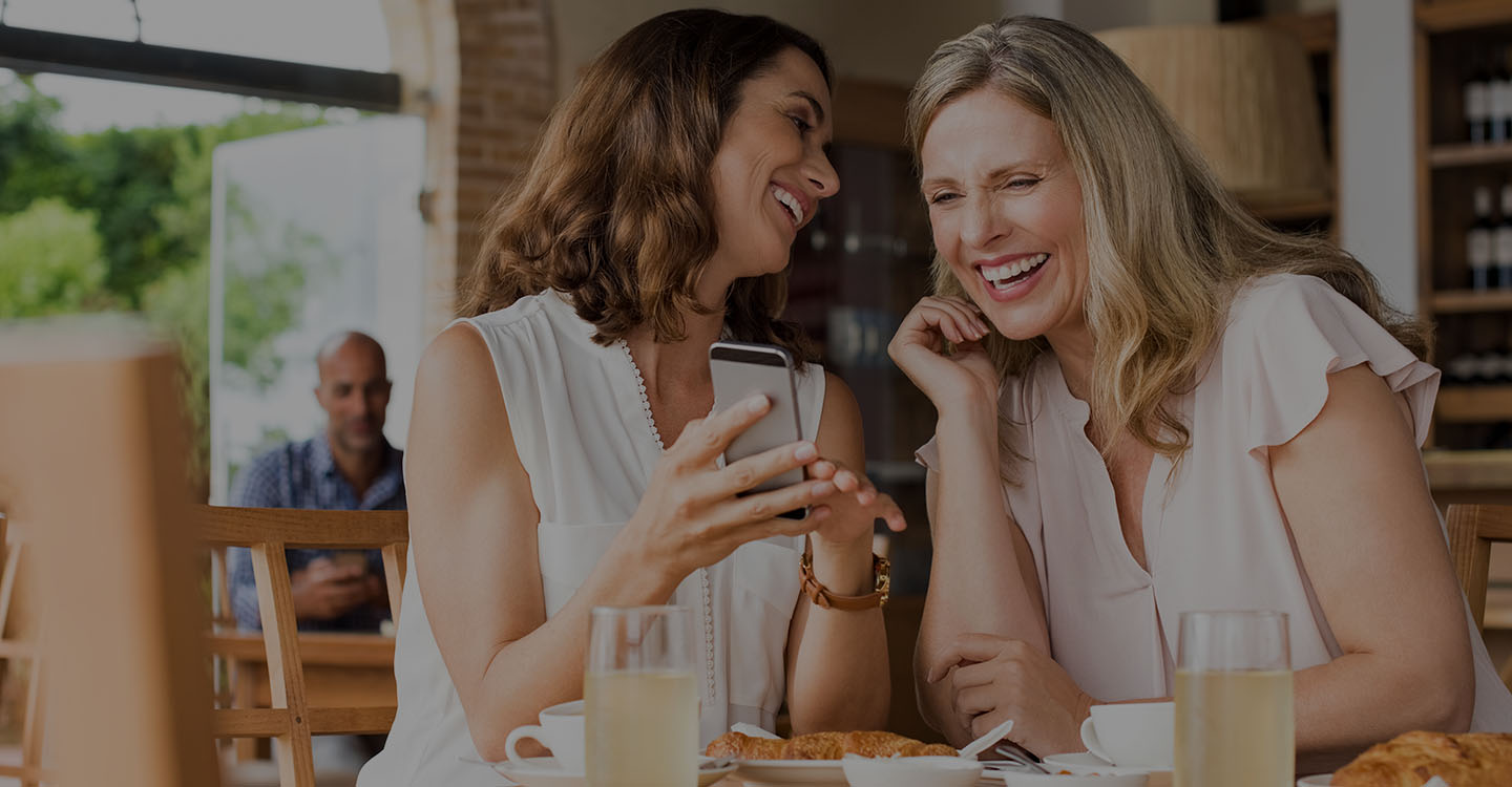 Women having lunch together and laughing