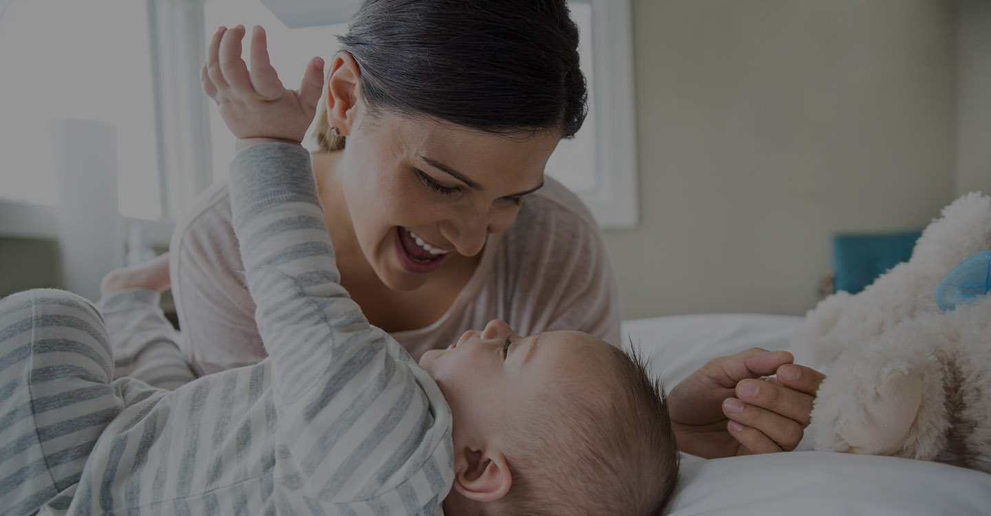 Mother and baby laughing together