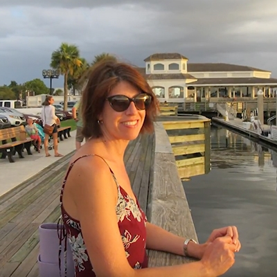 Florida woman smiling on florida pier