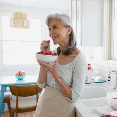 older woman eating fruit