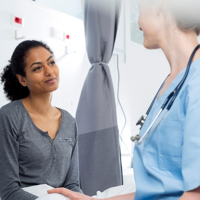 Female patient consulting a physician about her upcoming surgery